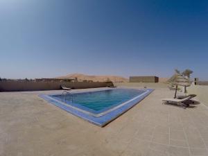 pool overlooking the dunes in the kasbah