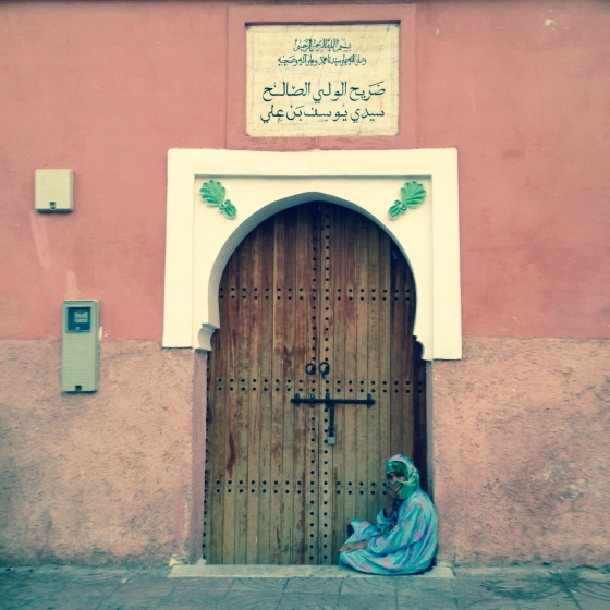 A woman at the door of the shrine of Sidi Yousaf Ben Ali. I was told the shrine has been closed to public for some time.